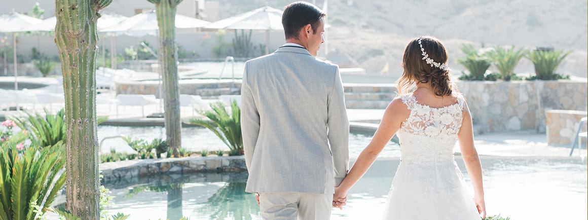 Married couple walking by the pools