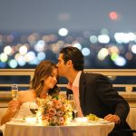Couple Dining by Rooftop Pool