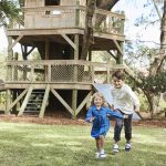 Kids by the treehouse