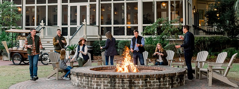 Group around River House Fire Pit