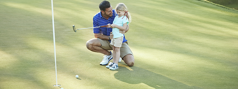 Dad and daughter golf