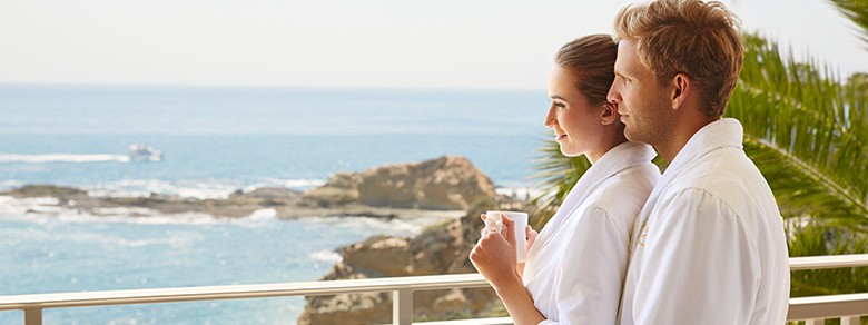 Couple Enjoying In-Room Dining on Their Pation at Montage Laguna Beach
