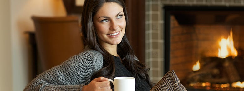 Woman Enjoying a Cup of Coffee at Buzz in Montage Deer Valley