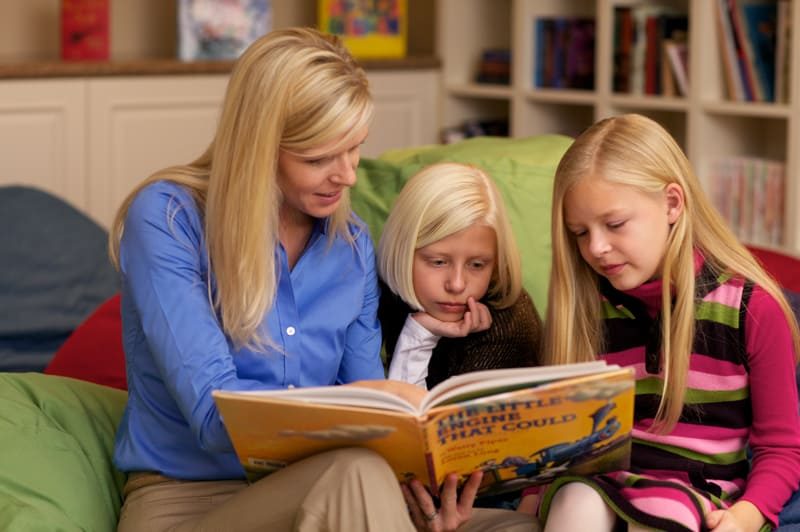 Mother reading to daughters in Paintbox