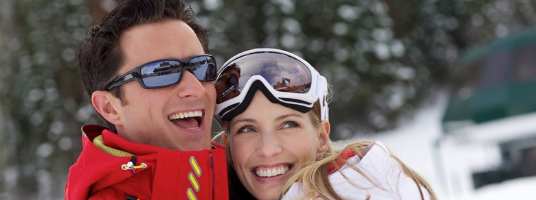 skier couple laughing outside