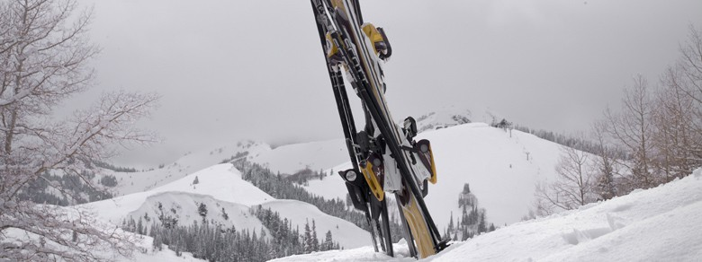 skis stuck in snow outside winter