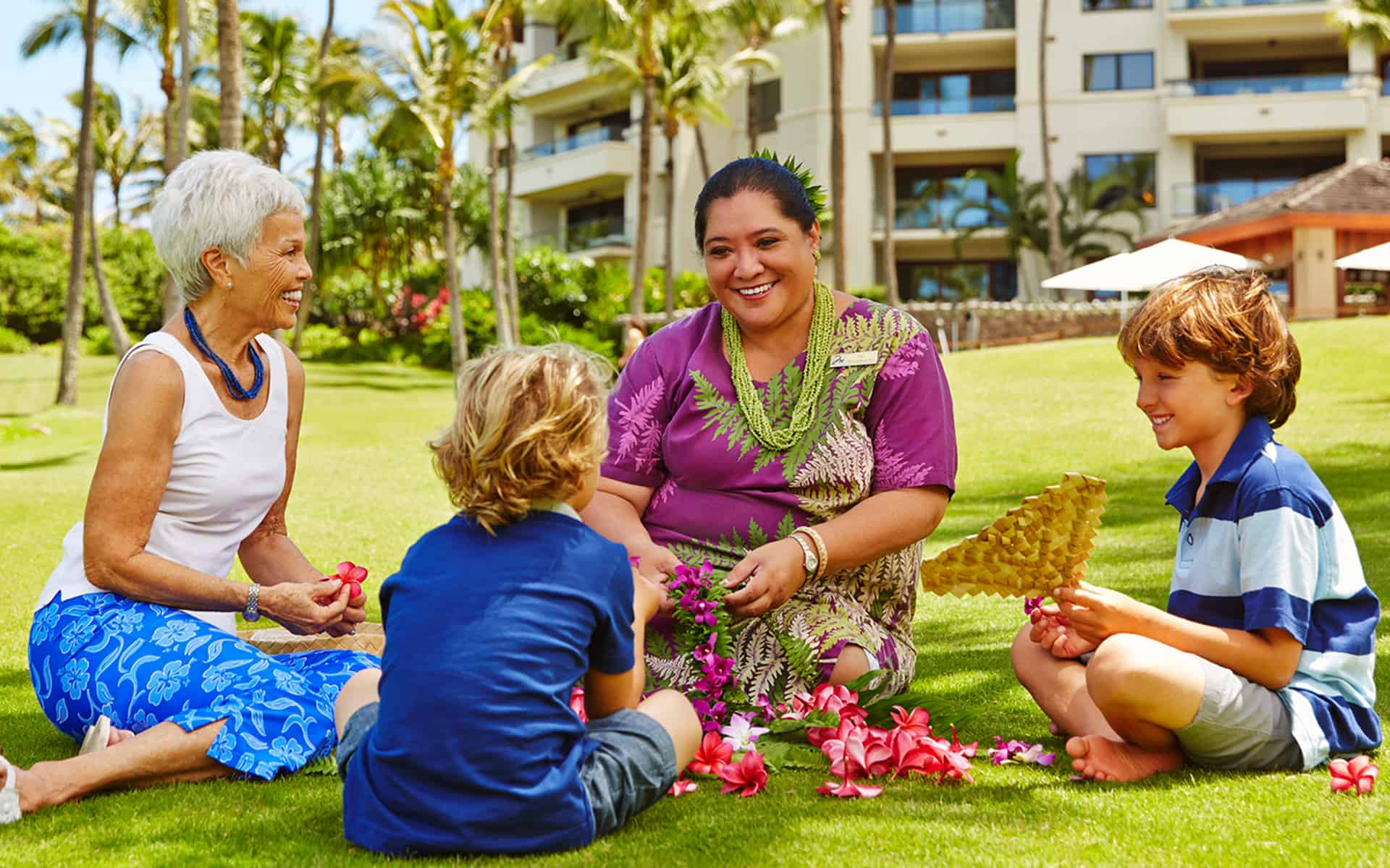 Best Maui Resorts for Families: Where to Stay on Maui with Kids featured by top Hawaii blog, Hawaii Travel with Kids: https://uploads.montagehotels.com/u/sites/5/2015/04/lei-making-hero.jpg